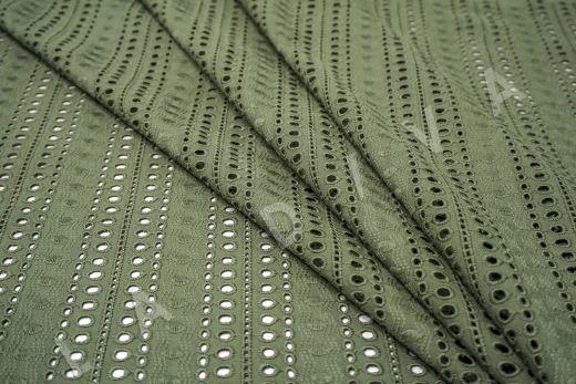 Шитье серо-зеленого цвета с геометрической вышивкой